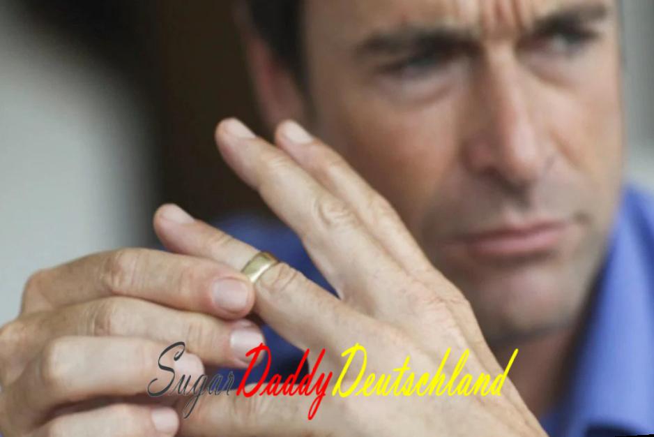 Trauriger geschiedener Mann nimmt seinen Ring ab
